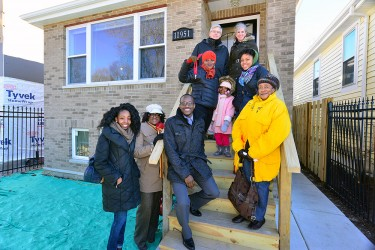 A winter home dedication ceremony for a one of our affordable homeownership families