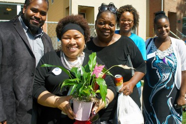Habitat homebuyers greet each other