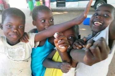 Malawi children pose for the camera on a recent international build trip filled with Chicago volunteers