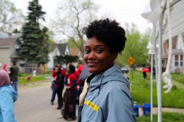 A Habitat volunteer at a community clean up day