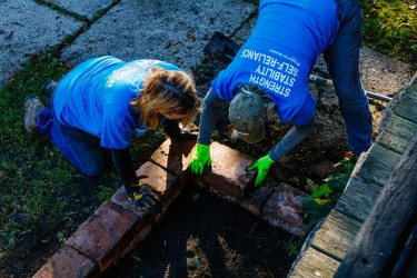 Two Habitat volunteers work on a home repair project
