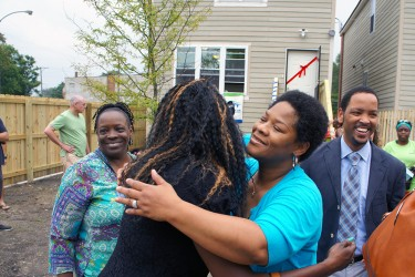 Neighbors greet each other at a Habitat Chicago home