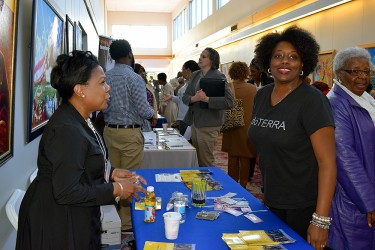 Community members plan together at a resource fair
