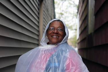 West Pullman resident smiles through the rain on a community clean up day
