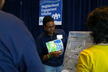 West Pullman resident discusses area assets with Habitat Chicago volunteers