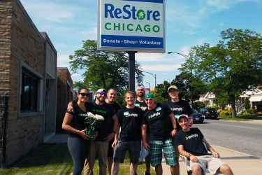 A group of friends volunteering at ReStore Chicago, where used goods are sold to help the Habitat mission