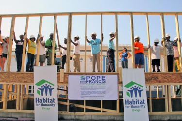 A wall raising during the Pope Francis Home Challenge