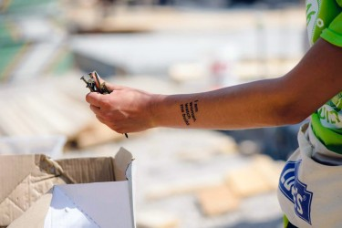A Habitat Women Build volunteer shows off her temporary tattoo while gathering nails for a wall