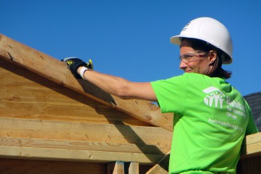 Women Build volunteer advances new home construction of a future woman homeowner