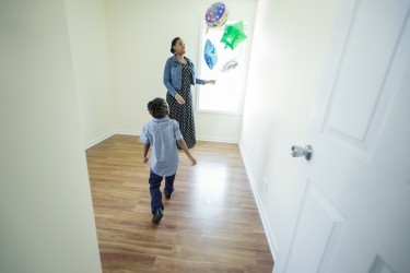Mother and son enjoy the space available to them in their new Habitat Chicago home