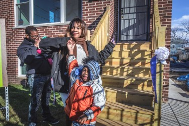 Aphriditie and family celebrate cutting the ribbon on their new, affordable Habitat Chicago home