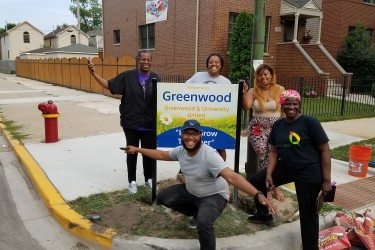 Residents of a block club celebrate new neighborhood signage