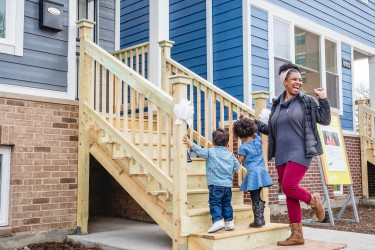 A Habitat Chicago Homeowner celebrates at her home dedication ceremony