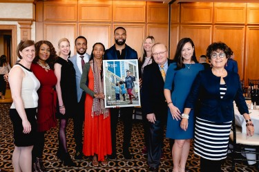Matt Forte and Habitat Chicago homeowner, Shelonda, pose with Benefit Breakfast guets