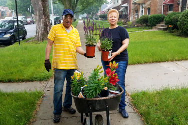 West Pullman residents plant flowers in their yard during a project funded by Habitat for Humanity
