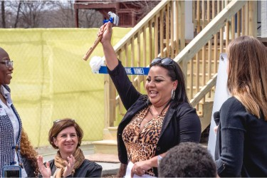 Homebuyer receiving gift at home dedication