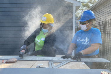 Women Builder Cutting Siding at Women Build 2020