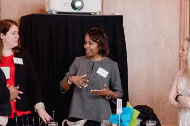 Attendees conversing at a Habitat Chicago fundraising event